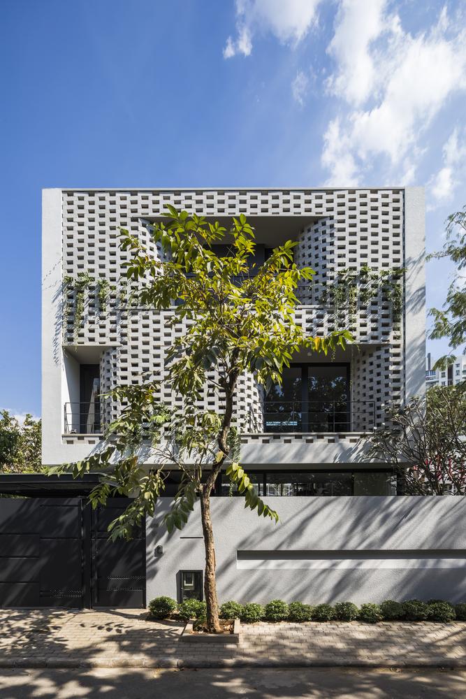 Nhà Xếp tầng / Nha Dan Architects